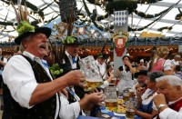 Revellers salute with beer after the opening of the 179th Oktoberfest in Munich